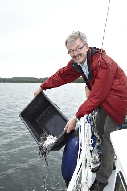 The Minister for Food, Agriculture and Fisheries, Mr Henrik Høegh restocking Juelsminde Fjord